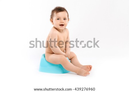 baby smiling and sitting on the potty - stock photo