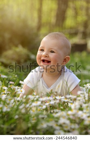 baby smiling in flower