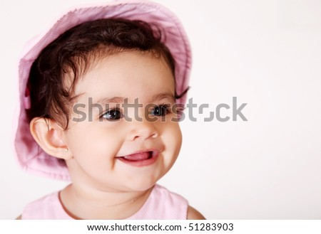 baby smiling over white background. Pink dress