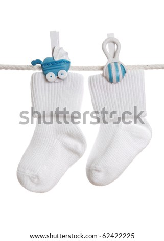 Baby socks hanging on the clothesline - stock photo