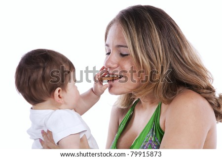 baby son sharing a cookie with his mother (isolated on white) - stock photo