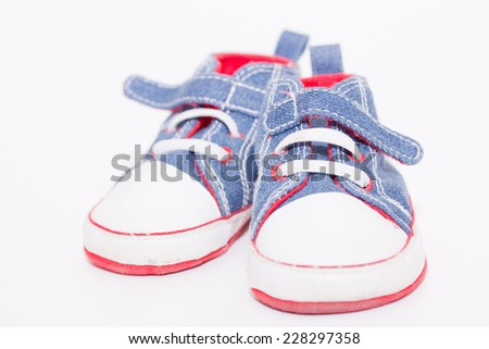 Baby sport shoes pair on white background