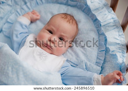 baby stretches in the cradle - stock photo