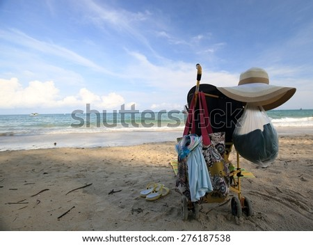 Baby stroller standing at a beach - stock photo