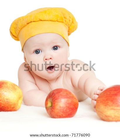 baby surrounded by red apples - stock photo