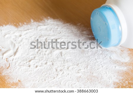 Baby talcum powder container on wooden background