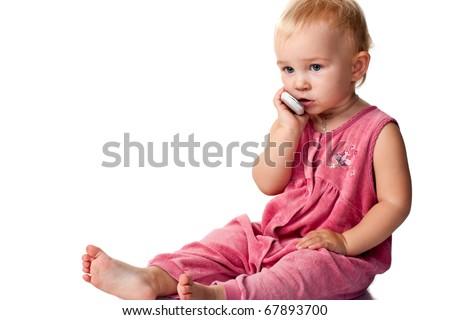 Baby talking on the mobile phone isolated on white