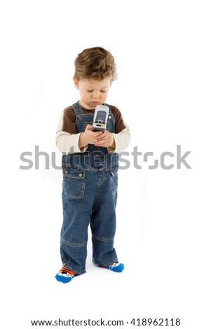 baby talks on mobile phone - stock photo