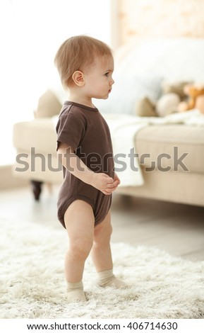 Baby walking along the room