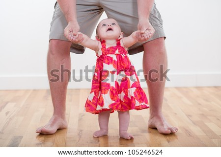 Baby Walking with Dad [6 Month Old] - stock photo