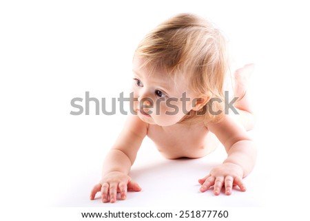 Baby watching attentive in a white isolated background - stock photo