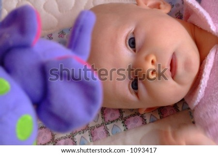 baby watching mobile - stock photo