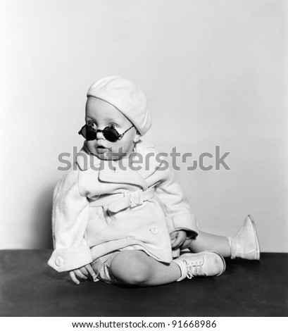 Baby wearing beret and sunglasses - stock photo