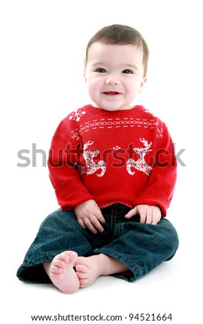 Baby wearing christmas jumper - stock photo