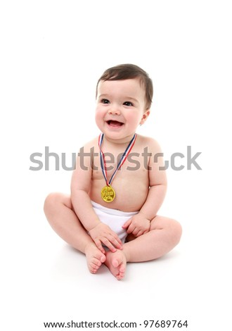Baby wearing medal - stock photo