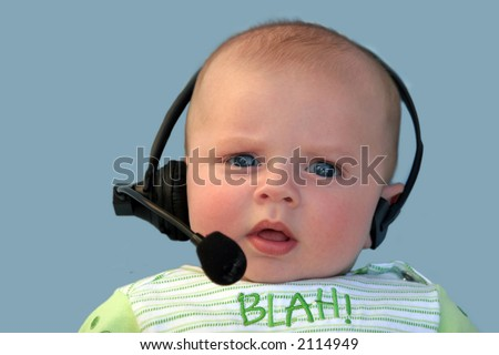 Baby with a headset on a blue background