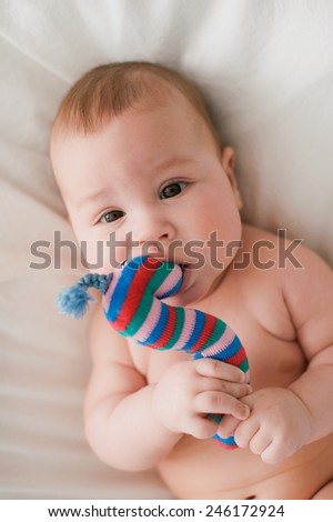 baby with a toy - stock photo