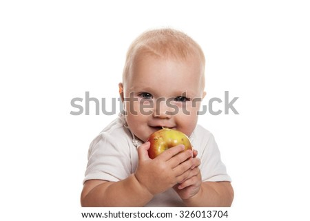 baby with an apple in a white dress on a white background