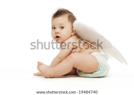 Baby with angel wings in diapers sitting sideways