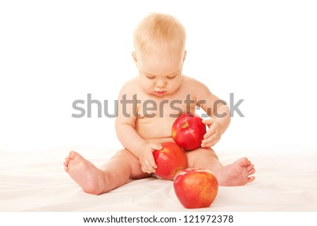 Baby with big red apples Isolated on white background.