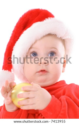 baby with blue eyes holding ornament - stock photo