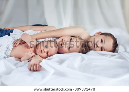 Baby with brother and sister - stock photo