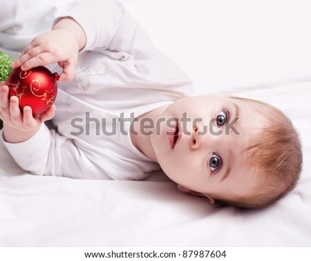 baby with christmas decoration on a white background. - stock photo