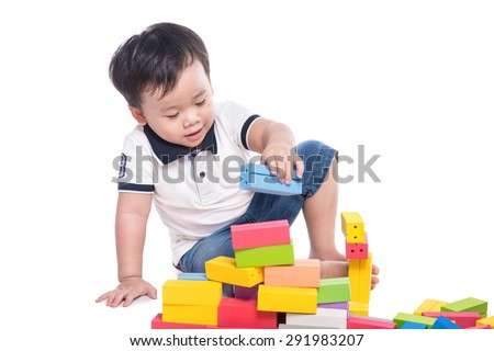 baby with construction set isolated on white background