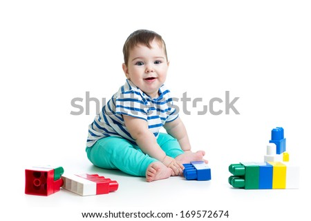 baby with construction set over white background - stock photo