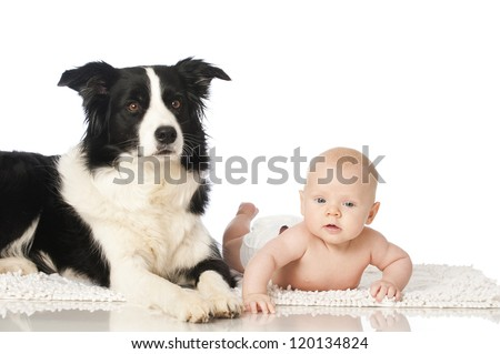 Baby with dog - stock photo