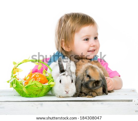baby with Easter bunny and two basket with eggs
