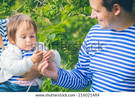 baby with father in the garden  - stock photo