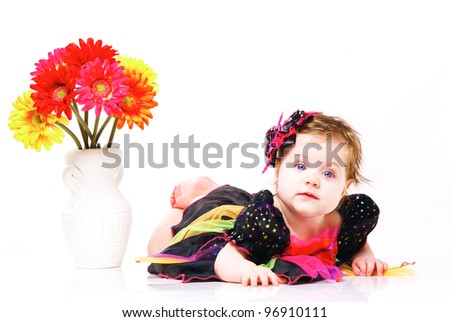 baby with flowers in white