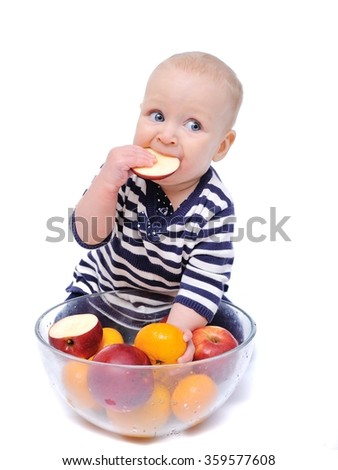 Baby with fruits in a clear bowl/charming baby with fruit lying in a transparent bowl; Isolated over White Background - stock photo