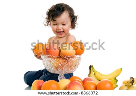 Baby with fruits,isolated on a white background. - stock photo