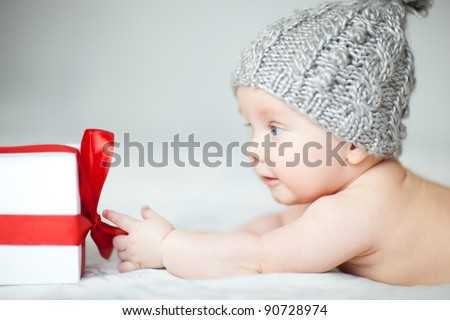 Baby with gift - stock photo