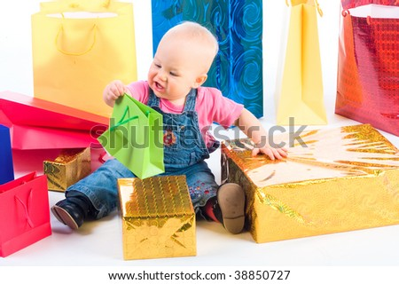 Baby with gifts isolated on white