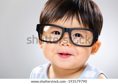 Baby with glasses - stock photo