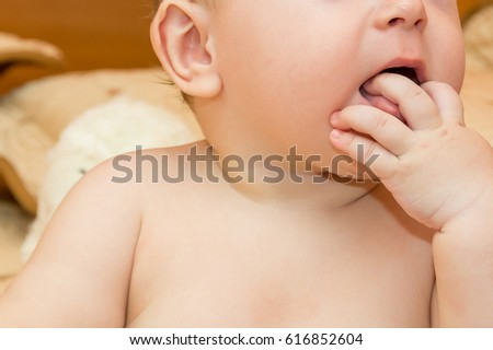 Baby with hand in mouth
