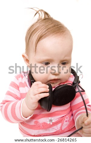 Baby with headphones on white