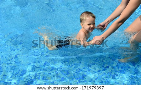 baby with her mother in the swimming pool