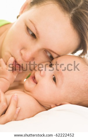 baby with her mother on the white background