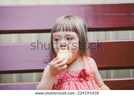 Baby with ice cream - stock photo