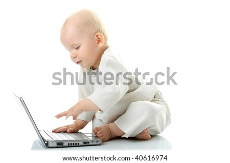 Baby with laptop on the white background - stock photo