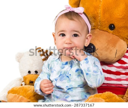 Baby with many teddies