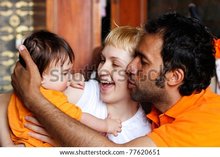 baby with mother and father in the room - stock photo