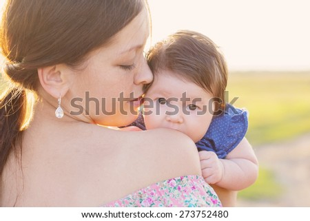baby with mother outdoor - stock photo