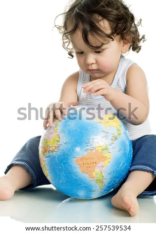 Baby with puzzle globe, isolated on a white background.