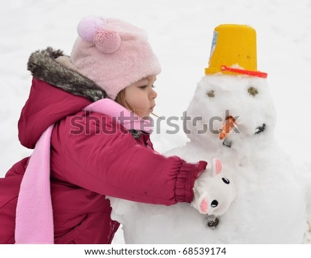 baby with snowman - stock photo