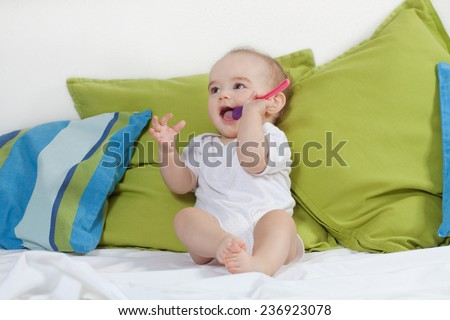 Baby with spoon  - stock photo